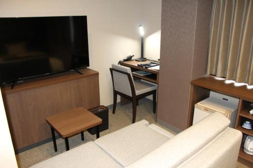 A television and/or entertainment center at Matsue Urban Hotel