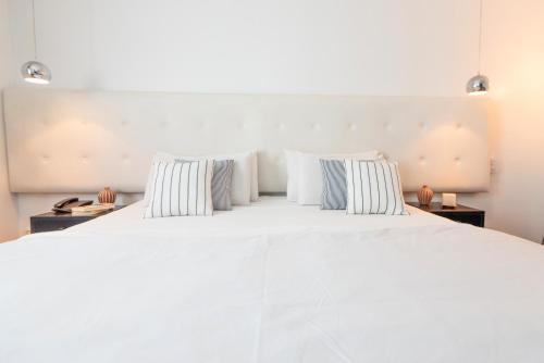 A bed or beds in a room at 5411 Soho Hotel