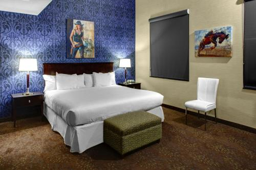 A bed or beds in a room at The Hotel by Gold Dust