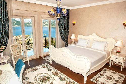 A bed or beds in a room at Swan Lake Hotel - Adult Only