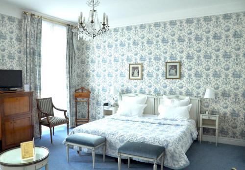Un ou plusieurs lits dans un hébergement de l'établissement Grand Hôtel Des Templiers
