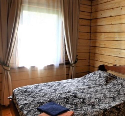 Кровать или кровати в номере Малиновый Остров