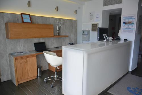 Una cocina o zona de cocina en Natalino Hotel Patagonia