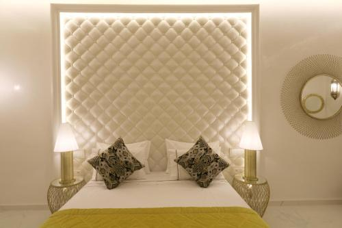 A bed or beds in a room at Riad Andalla Spa