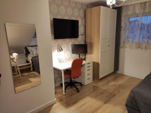 Telewizja i/lub zestaw kina domowego w obiekcie Pietrzak Apartments