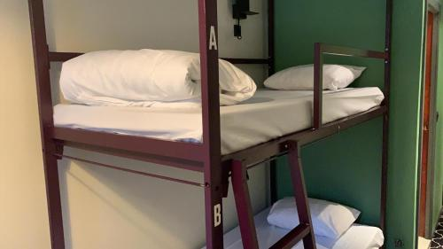 A bunk bed or bunk beds in a room at Safestay Brussels