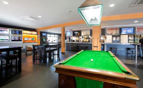 A pool table at Mowbray Hotel