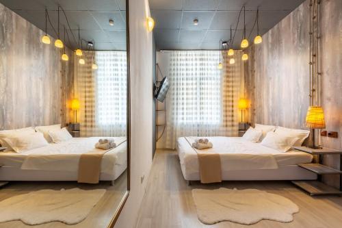 Кровать или кровати в номере Гостиница Ананас