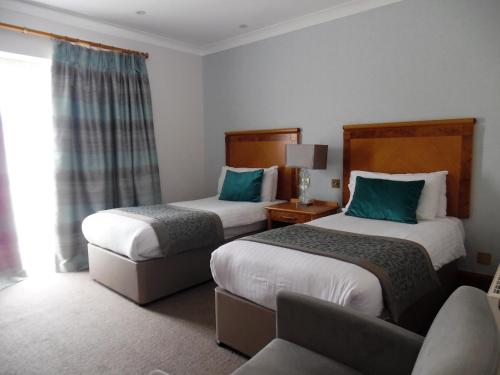 A bed or beds in a room at Dale Hill Hotel