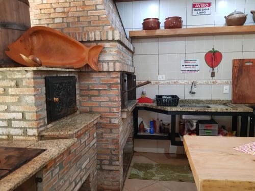 A kitchen or kitchenette at Pousada Sonho Meu Foz