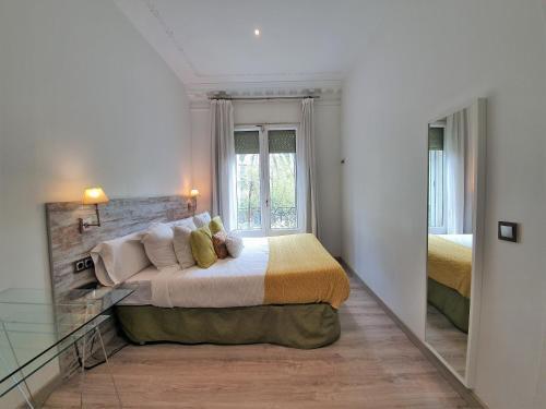 Cama o camas de una habitación en Kiwidestiny Barcelona City