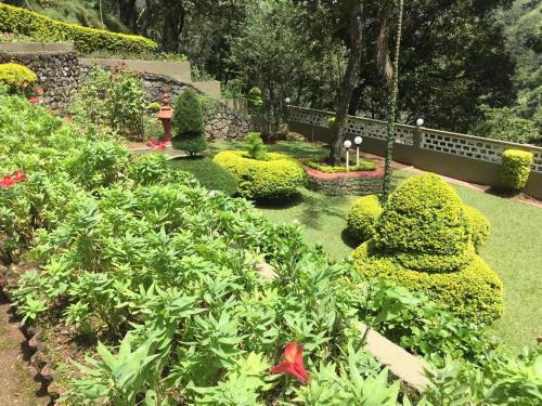 A garden outside Abad Copper Castle Resort
