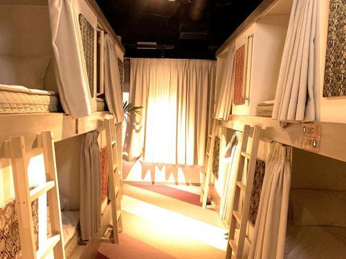 Un ou plusieurs lits superposés dans un hébergement de l'établissement Ueno Station Hostel Oriental Ⅰ