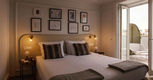 A bed or beds in a room at Lisboa Pessoa Hotel