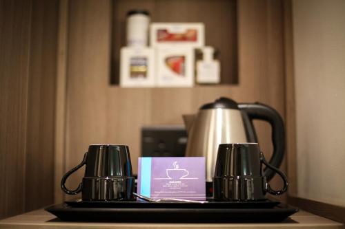 Coffee and tea-making facilities at MENA Plaza Hotel Albarsha