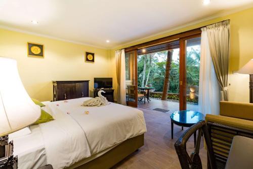 Ein Bett oder Betten in einem Zimmer der Unterkunft Umasari Rice Terrace Villa