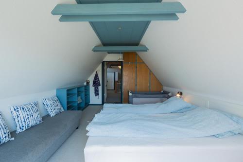 En eller flere senge i et værelse på The White House B&B
