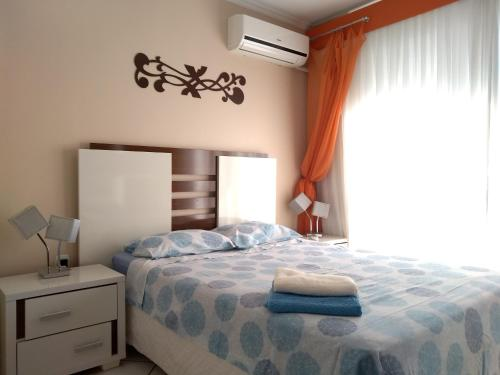 A bed or beds in a room at Apart Central Petit Vilage by MY HOME