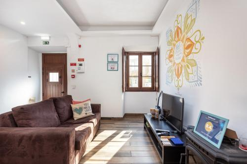 A seating area at Faro City Life Hostel