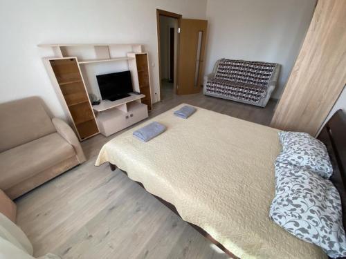 Кровать или кровати в номере Apartment in Kupchino