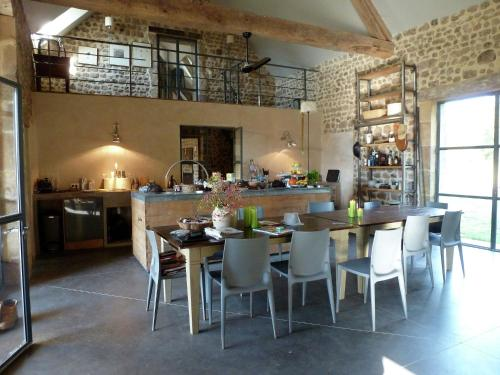 A restaurant or other place to eat at Luxury Farmhouse with Private Garden near Forest in Braize