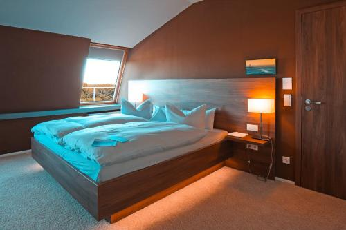 A bed or beds in a room at The Grand