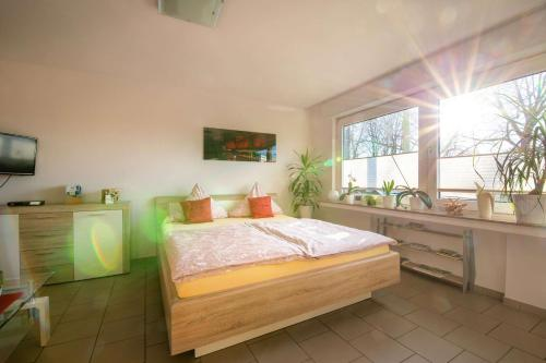 A bed or beds in a room at Innenstadt Appartement Essen