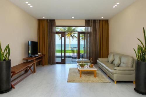Een zitgedeelte bij Palm Garden Beach Resort & Spa