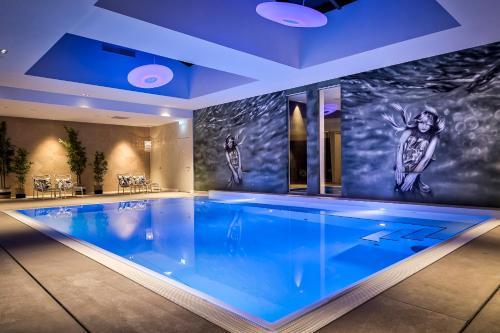 The swimming pool at or near Van der Valk Hotel Tilburg