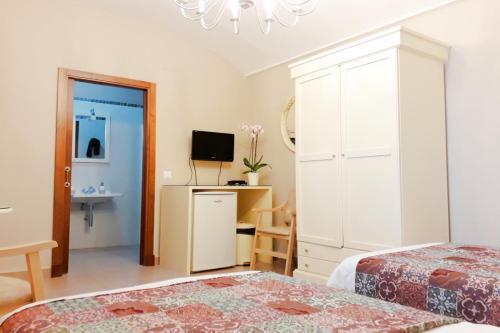 Cama o camas de una habitación en Posada Alegria