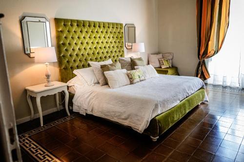 Letto o letti in una camera di B&B Palazzo Cerami