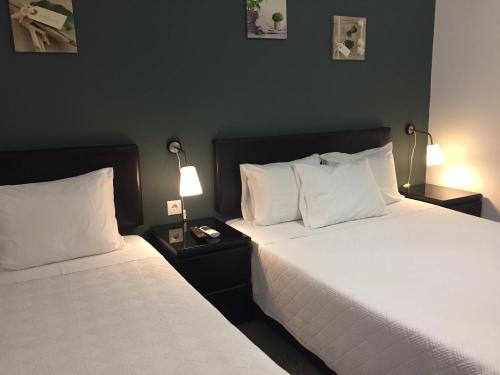 Uma cama ou camas num quarto em Residencial Principe Guest House