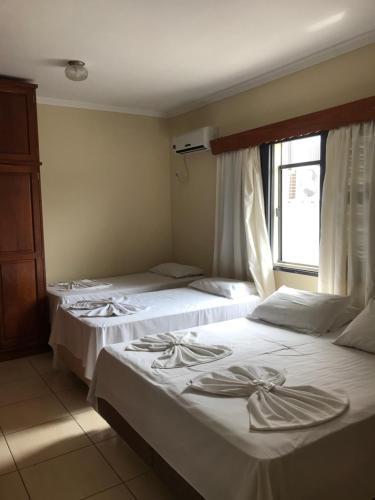 Cama ou camas em um quarto em Dein Haus Pousada