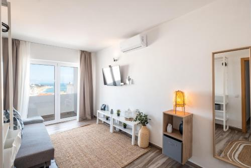 A seating area at Oceanic Rainbow Apartment - Albufeira
