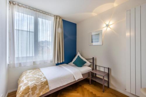 Ein Bett oder Betten in einem Zimmer der Unterkunft Hotel Oltnerhof