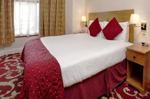 A bed or beds in a room at Best Western London Ilford Hotel
