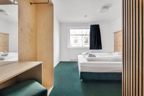 A bed or beds in a room at Sleepcph