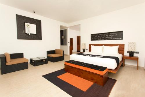 A bed or beds in a room at Aliya Resort and Spa
