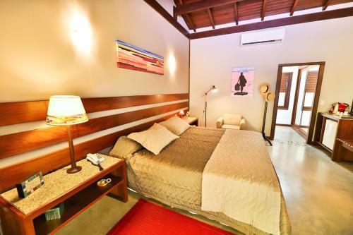 Cama ou camas em um quarto em Bupitanga Hotel