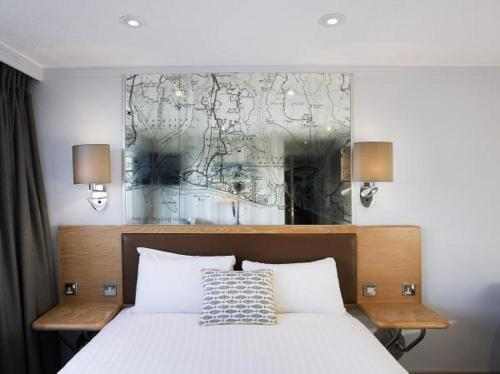 A bed or beds in a room at Langstone Quays Resort