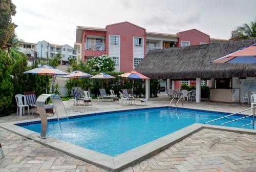 The swimming pool at or near Yatch Village Flat