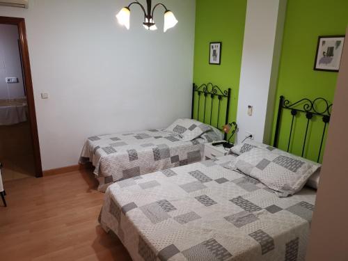 A bed or beds in a room at Hotel Mesón El Número Uno