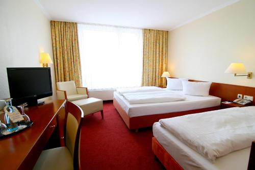 Ein Bett oder Betten in einem Zimmer der Unterkunft Alleehotel Europa