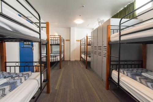 A bunk bed or bunk beds in a room at YHA Auckland International