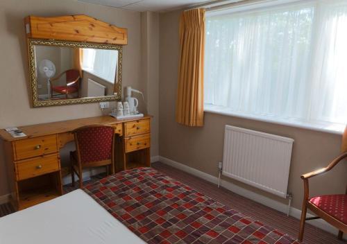 Cama o camas de una habitación en King Charles Hotel