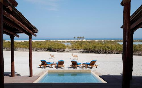 The swimming pool at or near Anantara Sir Bani Yas Island Al Yamm Villa Resort