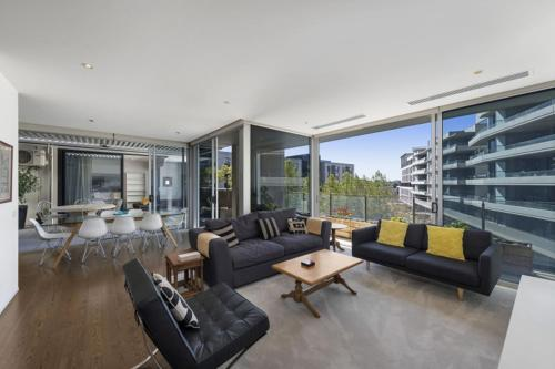 A seating area at Accommodate Canberra - Realm Residences