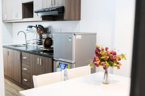 A kitchen or kitchenette at PARAGON CENTRE Hotel & Apartment