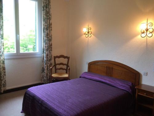 Un ou plusieurs lits dans un hébergement de l'établissement Hôtel Le Val Du Tech