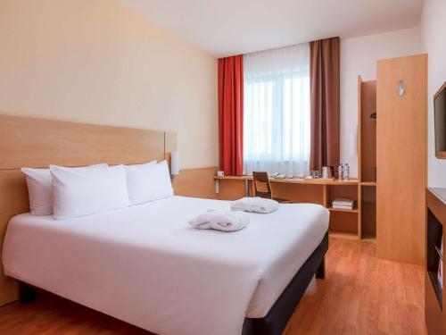 Cama o camas de una habitación en Ibis Moscow Centre Bakhrushina